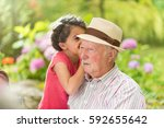 multi generations family having ... | Shutterstock . vector #592655642