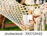 woman is reading book in the... | Shutterstock . vector #592715432