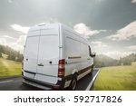 delivery van drives a day on a... | Shutterstock . vector #592717826