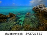clear turquoise sea and the... | Shutterstock . vector #592721582