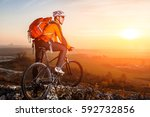 cyclist with mountain bike on... | Shutterstock . vector #592732856