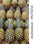 Pile Of Pineapples At A Market...