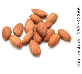 almond nuts isolated on white... | Shutterstock . vector #592742366