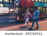 mixed race couple walking in... | Shutterstock . vector #592769312
