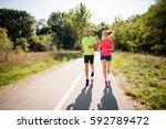 friends jogging together in ... | Shutterstock . vector #592789472