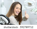 patient with perfect white... | Shutterstock . vector #592789712