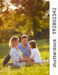 family in green nature together | Shutterstock . vector #592802342