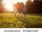 family with children run... | Shutterstock . vector #592802348