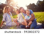 young family with children... | Shutterstock . vector #592802372