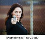 hispanic woman behind a wall... | Shutterstock . vector #5928487