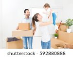 young family with a child moves ... | Shutterstock . vector #592880888