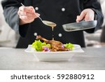 chef cooking restaurant food...   Shutterstock . vector #592880912