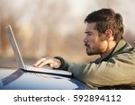 man working on computer | Shutterstock . vector #592894112