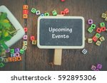 Small photo of word UPCOMING EVENTS on wooden signage,artificial plant and alphabetical block concept.fade color effect
