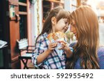 mom with her 6 years old... | Shutterstock . vector #592955492
