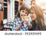 mom with her 6 years old... | Shutterstock . vector #592955495