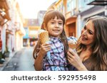 mom with her 6 years old... | Shutterstock . vector #592955498