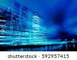 light trails on modern building ... | Shutterstock . vector #592957415