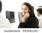 businesswoman working in call... | Shutterstock . vector #592961192