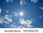 blue sky with clouds and sun...   Shutterstock . vector #592984292