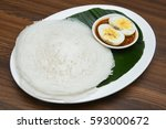 Small photo of Appam / Palappam / plain hoppers made of white rice powder, a popular traditional Kerala breakfast bread with spicy masala egg curry on a houseboat, Alappuzha or Alleppey, India. South Indian food.