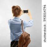 beautiful female tourist taking ... | Shutterstock . vector #593014796