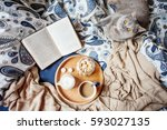 Stock photo an open book a british cat and a coffee in bed 593027135