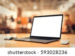 laptop with blank screen on... | Shutterstock . vector #593028236