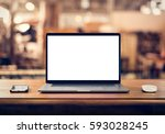 laptop with blank screen on... | Shutterstock . vector #593028245