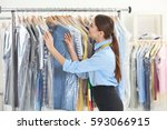 female worker in dry cleaning... | Shutterstock . vector #593066915
