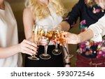 hands holding the glasses of... | Shutterstock . vector #593072546