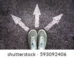 shoes and arrows pointing in... | Shutterstock . vector #593092406