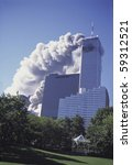 NEW YORK - SEPTEMBER 11: Smoke billows from the Twin Towers due to impact damage from airliners on September 11, 2001 in New York. - stock photo