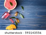 aroma oil with citrus on color... | Shutterstock . vector #593143556