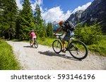 mountain biking woman and young ... | Shutterstock . vector #593146196