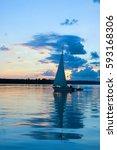 A Lone Sail Boat At Sunset ...