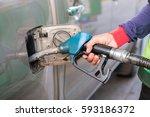 hand holding a blue fuel pump ... | Shutterstock . vector #593186372