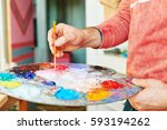 artist holding painting brush... | Shutterstock . vector #593194262