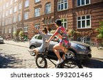 trendy young women riding along ... | Shutterstock . vector #593201465