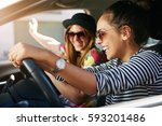 two lively young women driving... | Shutterstock . vector #593201486