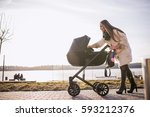 Young Mother Walking With Baby...