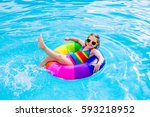 happy little girl playing with... | Shutterstock . vector #593218952
