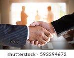 businessmen handshaking in a... | Shutterstock . vector #593294672