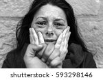 woman with bruised eyes in... | Shutterstock . vector #593298146