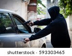 Robber thief Criminal Bandits in Robes Standing Next gun robbed and forced open the car door. To seize the property of the Victim.Thief Concept Photo. - stock photo