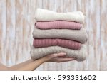 stack of warm pastel sweaters ... | Shutterstock . vector #593331602