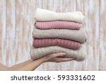 stack of warm pastel sweaters ... | Shutterstock . vector #593331602