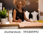 a young fashion designer... | Shutterstock . vector #593385992