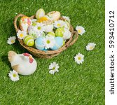 decorated easter eggs in the... | Shutterstock . vector #593410712