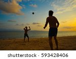 two guys plays in volleyball on ... | Shutterstock . vector #593428406